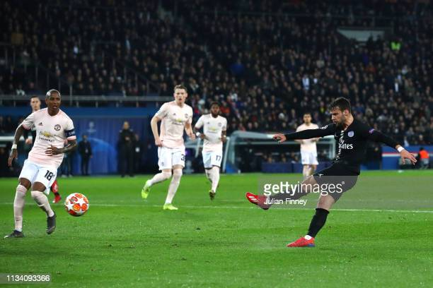 Juan Bernat of PSG shoots on goal during the UEFA Champions League Round of 16 Second Leg match between Paris SaintGermain and Manchester United at...