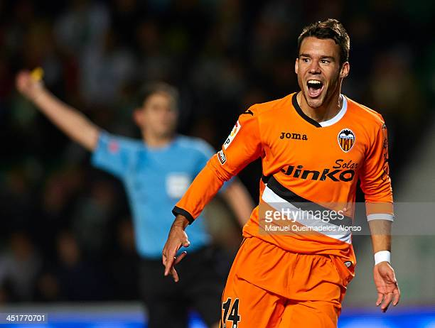 Juan Bernat of Valencia celebrates after scoring during the La Liga match between Elche FC and Valencia CF at Manuel Martinez Valero on November 24...
