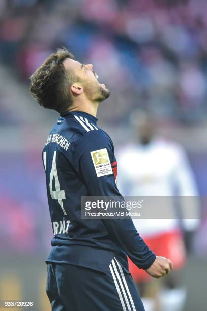 Juan Bernat Velasco of Bayern Muenchen reacts during the Bundesliga match between RB Leipzig and FC Bayern Muenchen at Red Bull Arena on March 18...