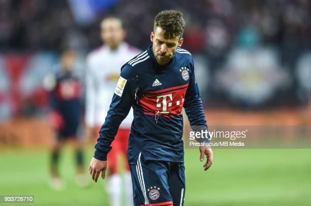 Juan Bernat Velasco of Bayern Muenchen spits during the Bundesliga match between RB Leipzig and FC Bayern Muenchen at Red Bull Arena on March 18 2018...