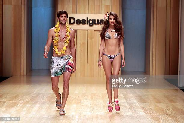 Juan Betancourt and Clara Alonso walk the runway during the Desigual show as part of the 080 Barcelona Fashion Spring/Summer 2015 on July 1 2014 in...