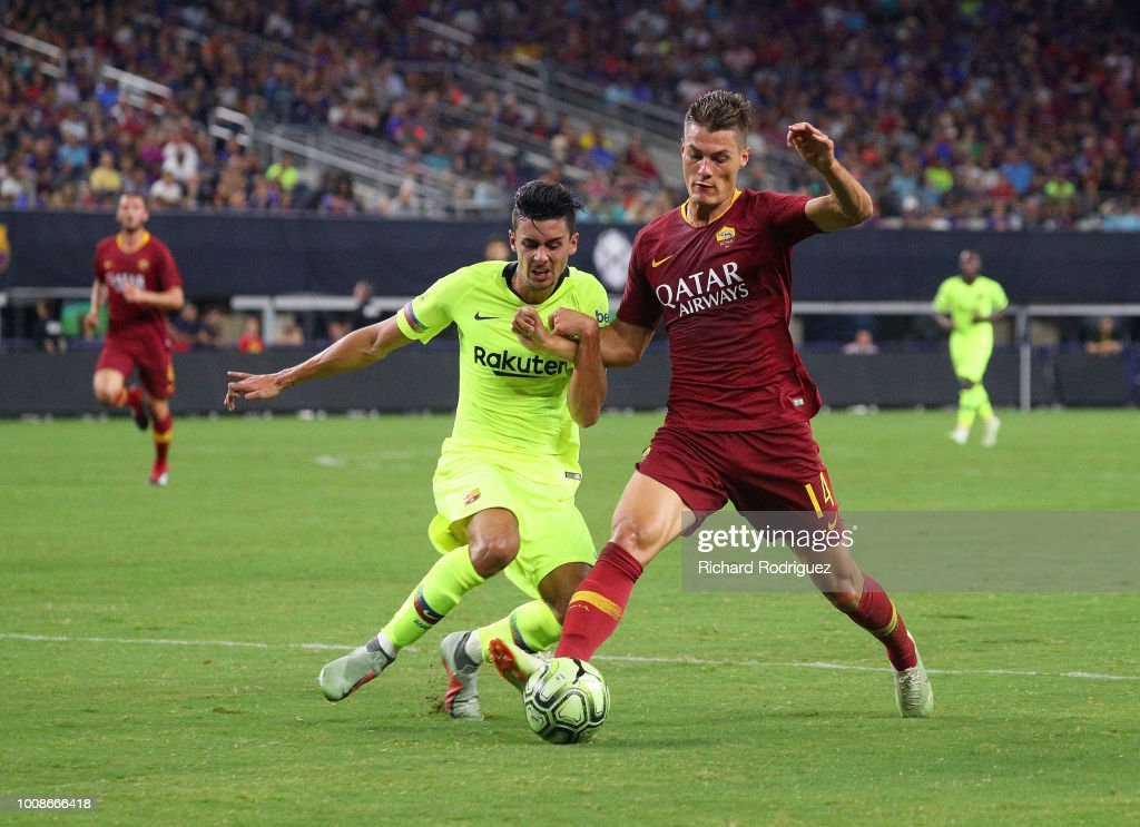 Juan Brandariz #16 of Barcelona and Patrik Schick #14 of Roma battle for the ball in the second half of a soccer match at AT&T Stadium on July 31, 2018 in Arlington, Texas.