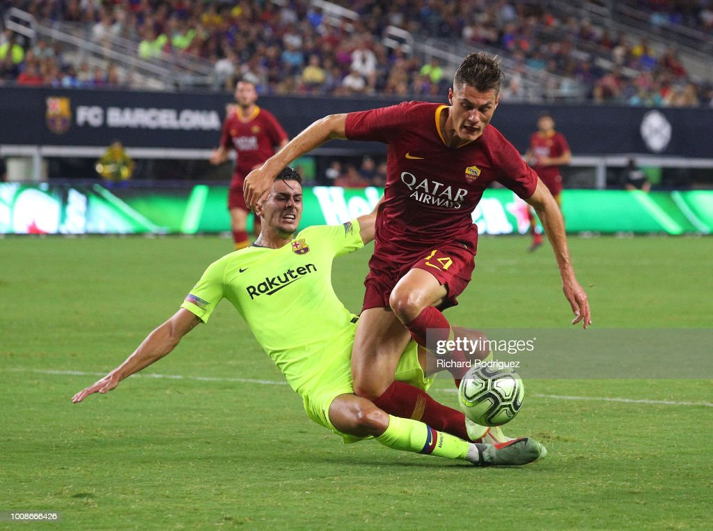 Juan Brandariz #16 of Barcelona fouls Patrik Schick #14 of Roma in the second half of a soccer match at AT&T Stadium on July 31, 2018 in Arlington, Texas. The foul set up a penalty shot that scored a goal.