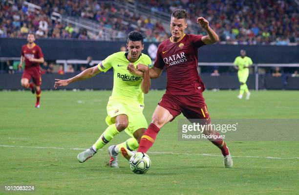 Juan Brandariz of FC Barcelona and Patrik Schick of AS Roma battle for the ball in the second half of the International Champions Cup match at ATT...