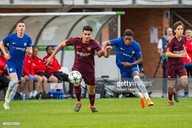 Juan Brandariz of FC Barcelona vies with Daishawn Redan of Chelsea FC during the UEFA Youth League Final match between Chelsea FC and FC Barcelona at...