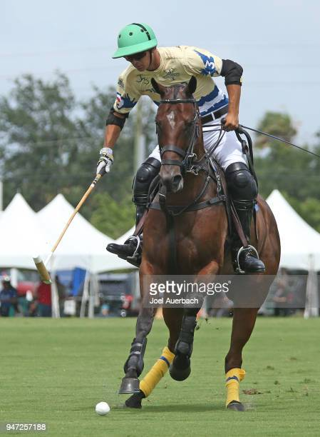 Juan Britos of Colorado brings the ball up field against the US Polo Assn during the Quarter final match of the US Open Polo Championship on April 15...