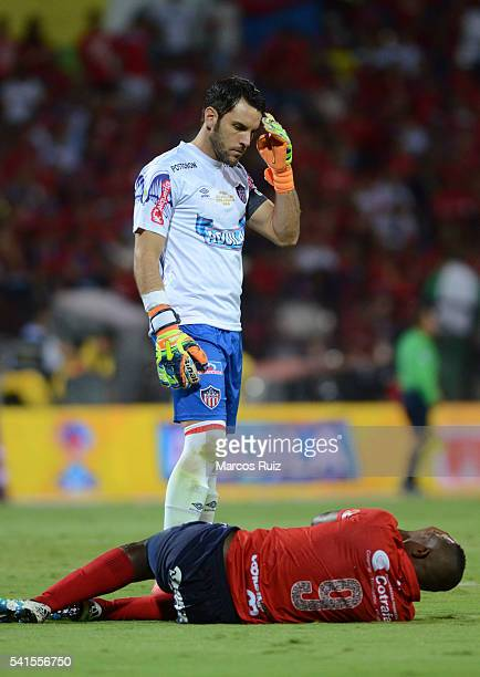 Juan Caicedo of Medellin lies on the ground next to Sebastian Viera of Junior during a second leg final match between Independiente Medellin and...