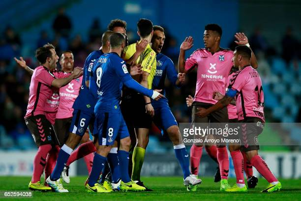 Juan Cala argues with Jesus Manuel Santana alias Suso NT of CD Tenerife and his teammate Antony Lozano during the La Liga second league match between...
