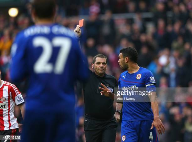 Juan Cala of Cardiff City is sent off by referee Phil Dowd during the Barclays Premier League match between Sunderland and Cardiff City at Stadium of...
