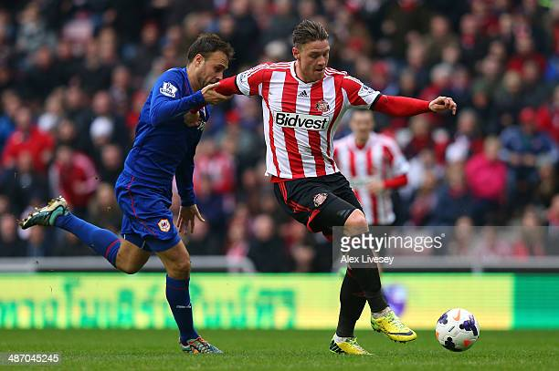 Juan Cala of Cardiff City pulls back Connor Wickham of Sunderland as he breaks through on goal and is subsequently sent off during the Barclays...