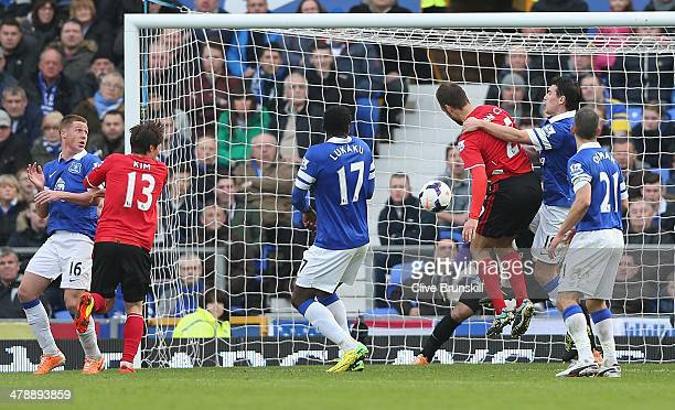 Juan Cala of Cardiff City scores his teams first goal during the Barclays Premier League match between Everton and Cardiff City at Goodison Park on...