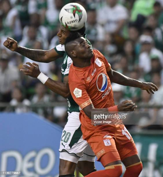 Juan Camilo Angulo of Cali vies for the ball with Misael Riascos of America during a match between Deportivo Cali and America de Cali as part of...