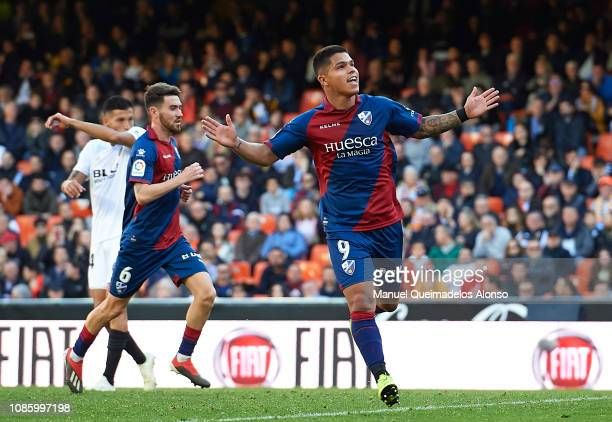 Juan Camilo Hernandez 'Cucho' of Huesca celebrates after scoring his sides first goal during the La Liga match between Valencia CF and SD Huesca at...