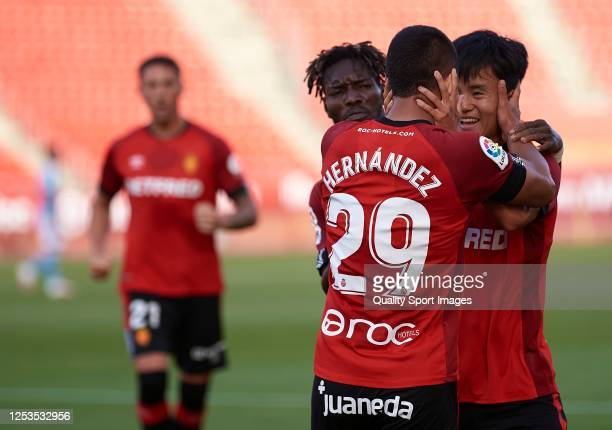 Juan Camilo Hernandez of Mallorca celebrates after scoring his team's second goal with his teammate Takefusa Kubo during the Liga match between RCD...