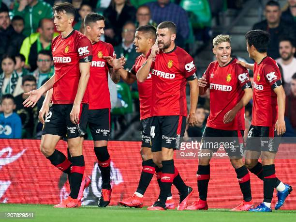 Juan Camilo Hernandez of RCD Mallorca celebrates after scoring his team's first goal with his teammates during the Liga match between Real Betis...