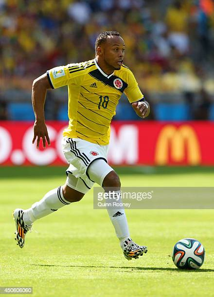 Juan Camilo Zuniga of Colombia runs with the ball during the 2014 FIFA World Cup Brazil Group C match between Colombia and Greece at Estadio Mineirao...