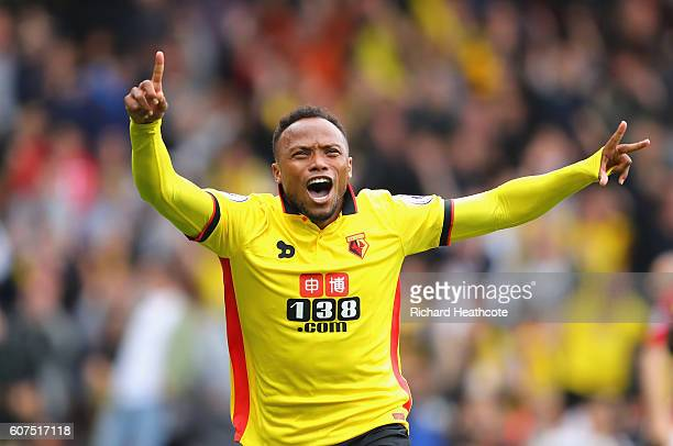 Juan Camilo Zuniga of Watford celebrates scoring his sides second goal with his team mates during the Premier League match between Watford and...