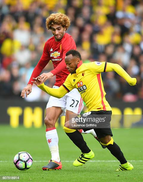 Juan Camilo Zuniga of Watford takes it past Marouane Fellaini of Manchester United during the Premier League match between Watford and Manchester...