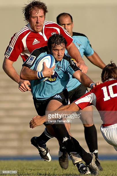 Juan Campomar of Uruguay is tackled during the Eliminatory Ford Word Wide 2011 New Zealand game between United States and Uruguay at Charrua Stadium...