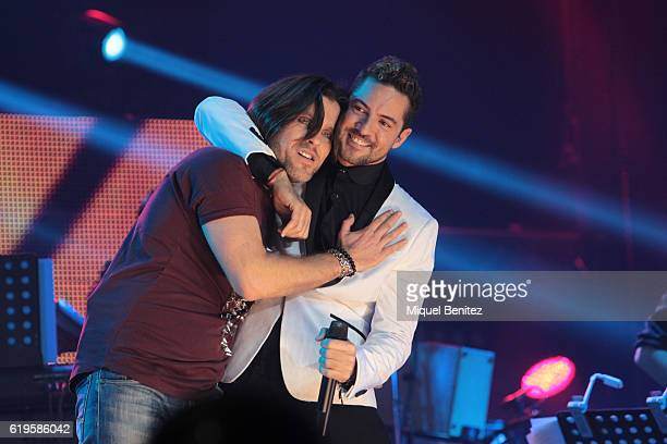 Juan Camus and David Bisbal perform on stage 'Operacion Triunfo El Reencuentro' Concert at Palau de Sant Jordi on October 31 2016 in Barcelona Spain