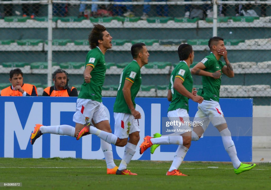 Juan Carlos Arce of Bolivia celebrates with teammates after scoring the first goal of his team during a match between Bolivia and Chile as part of FIFA 2018 World Cup Qualifiers at Hernando Siles Stadium on September 05, 2017 in La Paz, Bolivia.