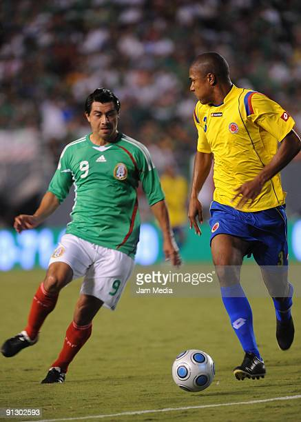 Juan Carlos Cacho of Mexicos vies for the ball with Alexis Enriquez of Colombia during their friendly match at the Cotton Bowl Stadium on September...