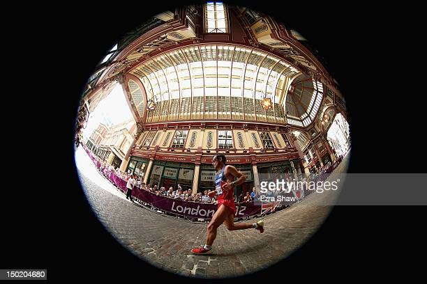 Juan Carlos Cardona of Colombia runs through Leadenhall Market as he competes in the Men's Marathon on Day 16 of the London 2012 Olympic Games on the...