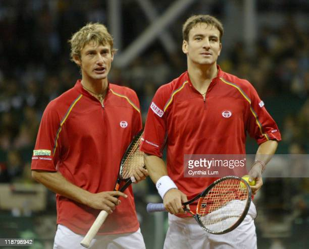 Juan Carlos Ferrero and Tommy Robred of Spain during their Davis Cup final doubles match against Mike Bryan and Bob Bryan of the United States at La...