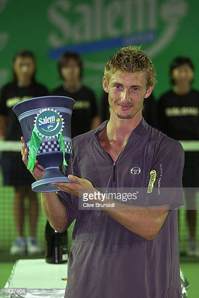 Juan Carlos Ferrero of Spain holds the trophy after his three set victory over Carlos Moya of Spain at the final of the Salem Open at Victoria Park...