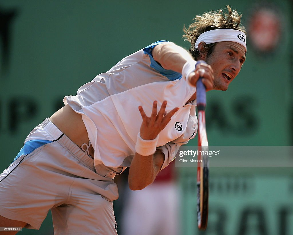 Juan Carlos Ferrero of Spain in action during his third round match against Marat Safin of Russia during the sixth day of the French Open at Roland Garros on May 28, 2005 in Paris, France.