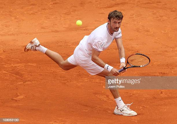 Juan Carlos Ferrero of Spain returns a backhand during his Quarter Final match against Florian Mayer of Germany during the International German Open...