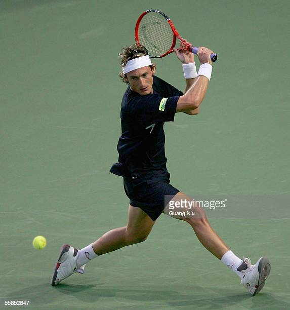 Juan Carlos Ferrero of Spain returns a ball during the men's single third round of China Open against David Nalbandian of Argentina at Beijing Tennis...
