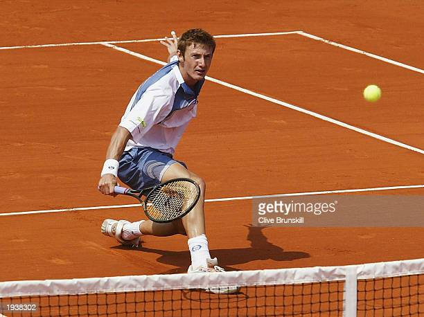 Juan Carlos Ferrero of Spain volleys during his straight sets victory over Alberto Martin of Spain during the quarterfinal of the Tennis Masters at...