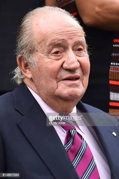 Juan Carlos former king of Spain takes his seat in the royal box for the women's singles final between US player Venus Williams and Spain's Garbine...