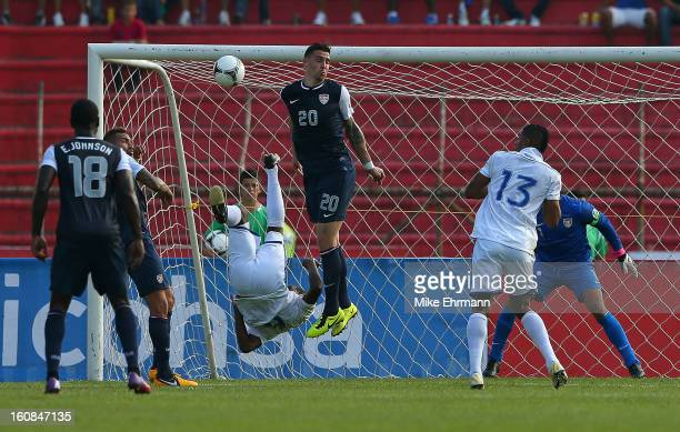 Juan Carlos Garcia of Honduras scores a goal past Geoff Cameron of the United States during a FIFA 2014 World Cup Qualifier at Estadio Olimpico...