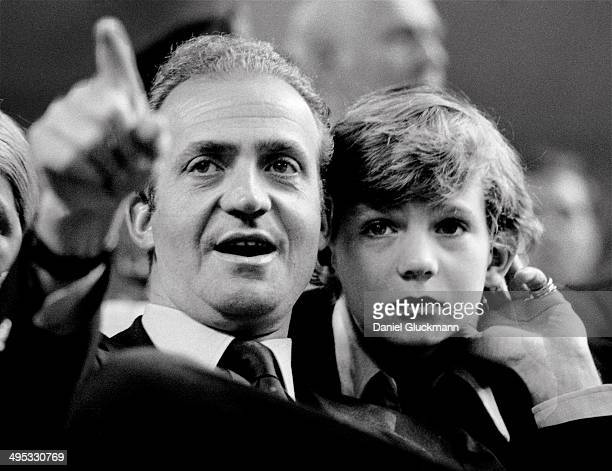 Juan Carlos, King of Spain, and his son the Prince Felipe watch a tennis match in Madrid, Spain in 1977. King Juan Carlos of Spain has renounced the...