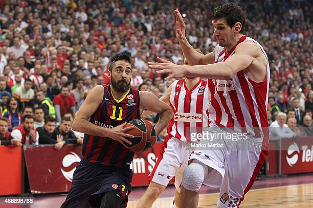 Juan Carlos Navarro #11 of FC Barcelona competes with Boban Marjanovic #13 of Crvena Zvezda Telekom Belgrade during the Turkish Airlines Euroleague...