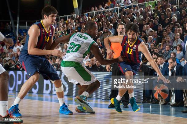 Juan Carlos Navarro #11 of FC Barcelona competes with Jekel Foster #20 of JSF Nanterre during the 20132014 Turkish Airlines Euroleague Regular Season...