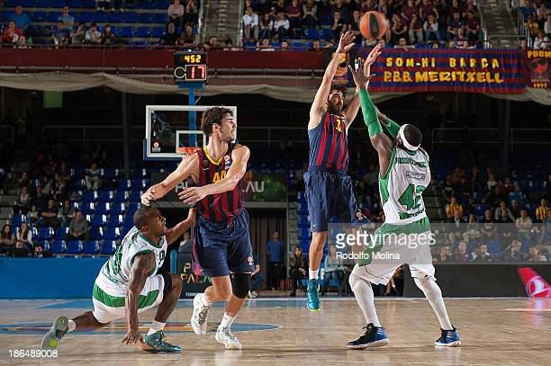 Juan Carlos Navarro #11 of FC Barcelona competes with Johan Passave #42 of JSF Nanterre during the 20132014 Turkish Airlines Euroleague Regular...