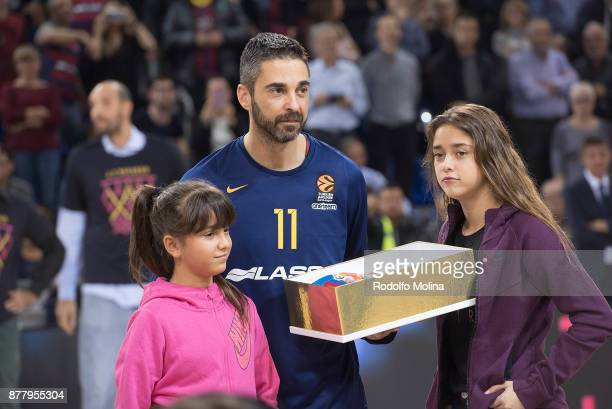 Juan Carlos Navarro #11 of FC Barcelona Lassa receive fro his daughters a gift commemorative after 20 years playing at club prior the 2017/2018...