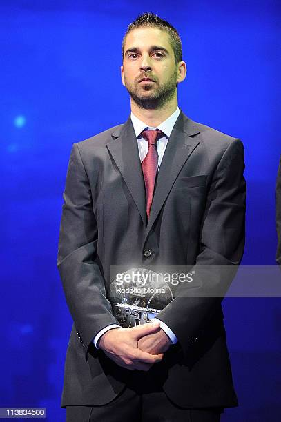 Juan Carlos Navarro #11 of Regal FC Barcelona poses with All Euroleague First Team Trophy during the Season Awards Ceremony of Turkish Airlines...
