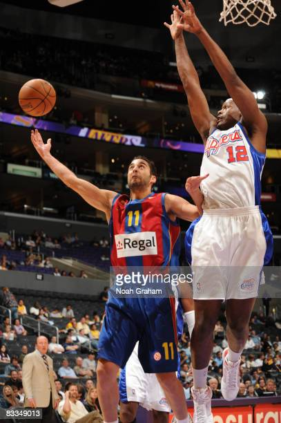 Juan Carlos Navarro of Regal FC Barcelona has his shot contested by Al Thornton of the Los Angeles Clippers at Staples Center on October 19 2008 in...