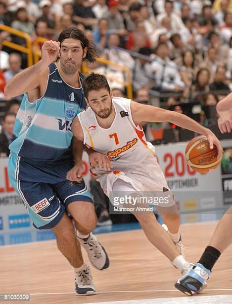 Juan Carlos Navarro protects the basketball from Argentinian Luis Scola during the FIBA World Championship 2006 Semi Final at the Saitama Super Arena...