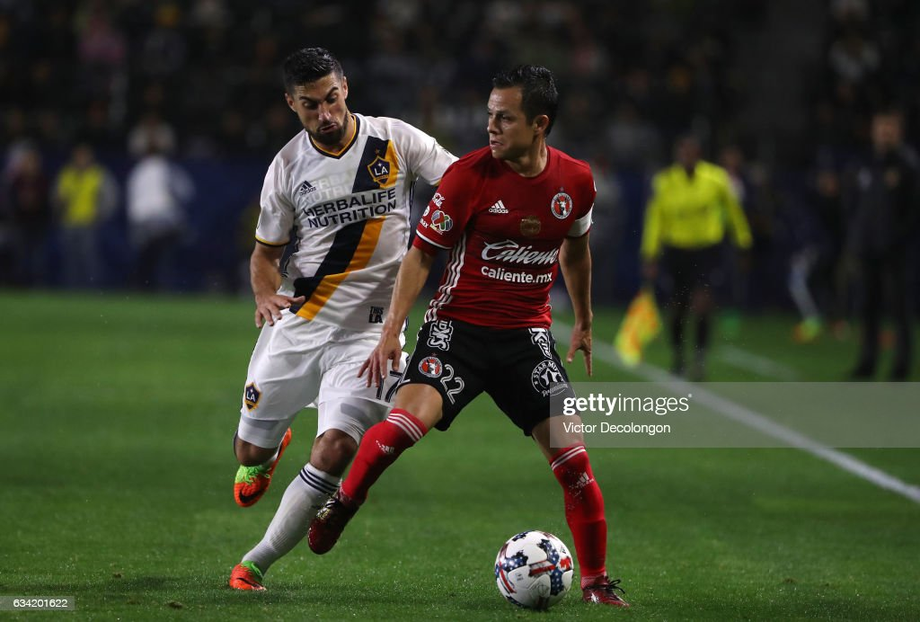 Juan Carlos Nunez #22 of Club Tijuana protects the ball from Sebastian Lletget #17 of the Los ANgeles Galaxy during the first half of their friendly match at StubHub Center on February 7, 2017 in Carson, California.