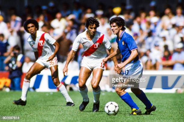 Juan Carlos Oblitas of Peru and Paolo Rossi of Italy during the World Cup match between Italy and Peru at Balaidos Stadium Vigo Spain on 18h June 1982