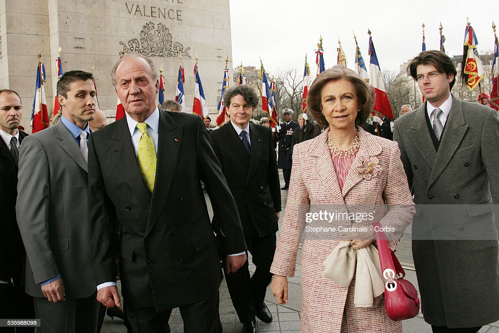 HRH Juan Carlos of Spain and HRH Sophia of Spain, with French Finance Minister Thierry Breton (R), at the Tomb of the Unknown Soldier, under the Arc de Triomphe in Paris, during their state visit.