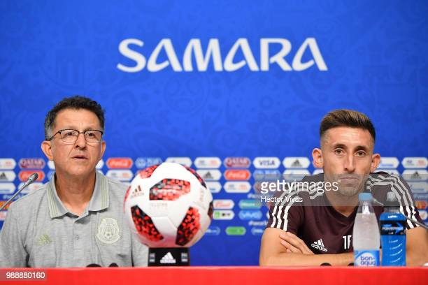Juan Carlos Osorio and Hector Herrera of Mexico speak during a press conference at Samara Arena ahead of the Round of Sixteen match against Brazil on...