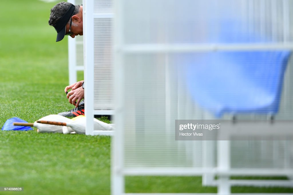 Juan Carlos Osorio, coach of Mexico, fasten his laces during a training session at team training base Novogorsk-Dynamo on June 14, 2018 in Moscow, Russia.