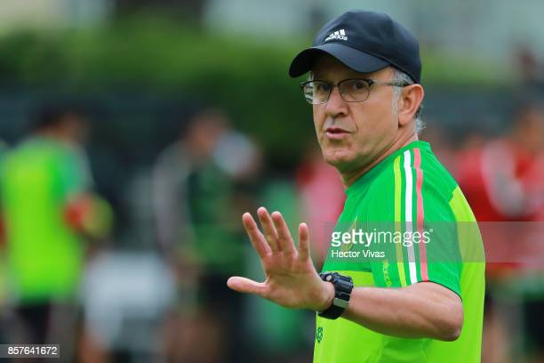 Juan Carlos Osorio coach of Mexico gestures during a Mexico's National Team training session ahead of the Qualifier match against Trinidad Tobago at...