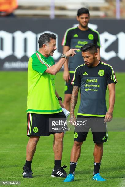 Juan Carlos Osorio coach of Mexico gives instructions to his player Javier Aquino during a training session at Centenario Stadium on August 28 2017...